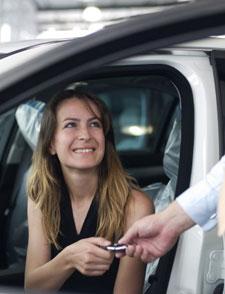 Women Getting Key In Car